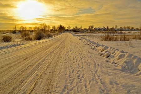 winter road in the village at sunset photo