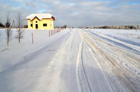 road to the house in winter landscape photo