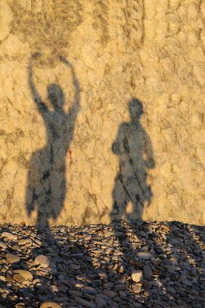 shade loving couple on a rocky beach photo