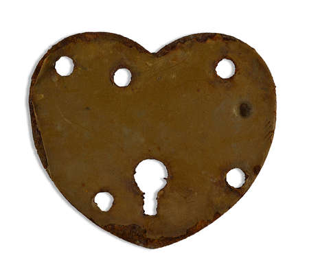 rusty heartshaped keyhole isolated on white photo