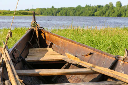 old antique boat in summer day on the river