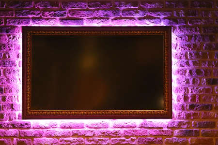 brick background with frame illuminated neon Foto de archivo
