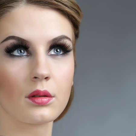 face of a young girl with vintage make-up