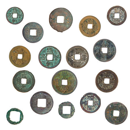 oxides: old, oxidized Chinese coins 1400-1900 years, isolated on a white background.