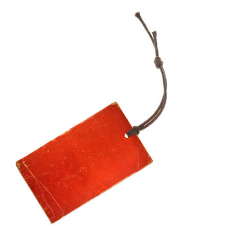 price tag on waxed cord from red paper, white background