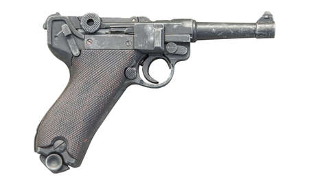 violence and trigger: old gun isolated on white background. The gun was used in 1940s
