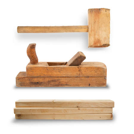 set of hand tools for joinery. Mallet, planer, stack of wooden planks isolated on white background