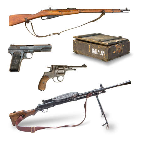 Antique weapons during World War II. pistols, rifles, machine guns, revolver, ammunition box. Stock Photo
