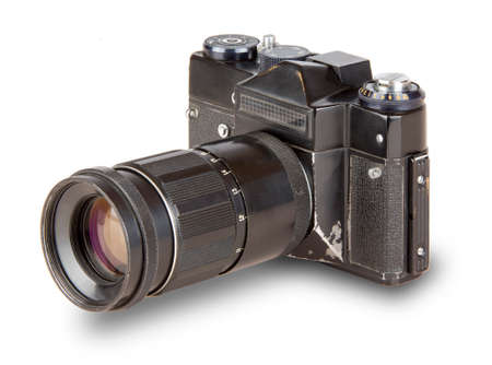 old, vintage, retro camera with telephoto lens isolated on white background