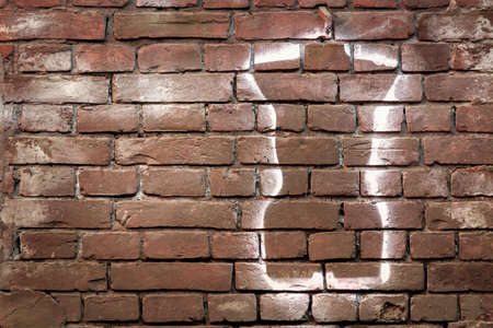 texture of a brick wall with graffiti and with space for text Stock Photo