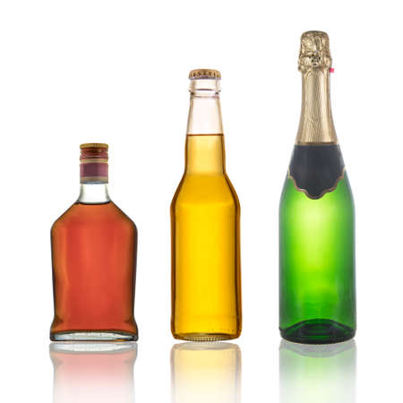 Bottles of cognac, champagne and beer with reflections isolated on a white background. Stock Photo