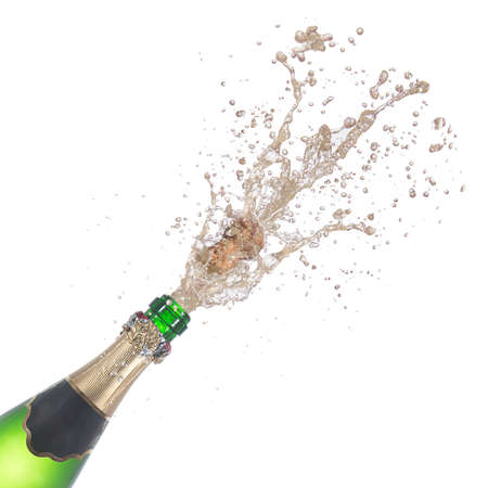 popping cork: bottle of champagne popping its cork and splashing isolated on white background