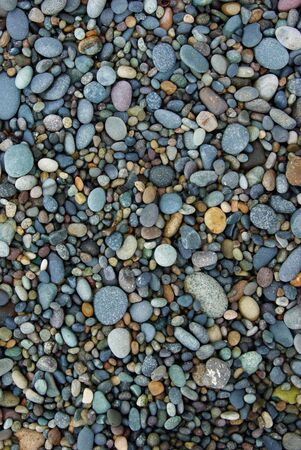Shiny Wet Multicolored Pebbles on Beach photo
