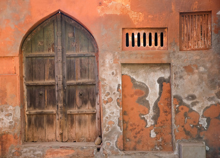dilapidated wall: an old vintage Indian door