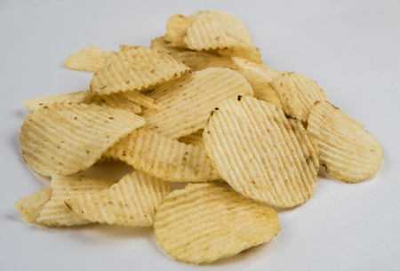 Pile of Wrinkled Wavy Potato Chips Isolated on White background