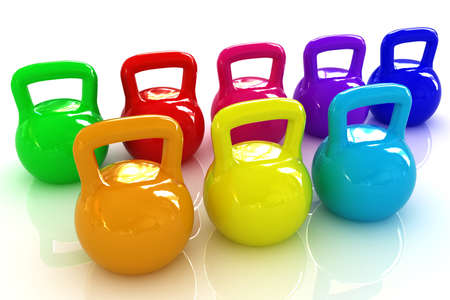 Colorful weights on a white background photo