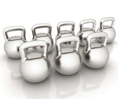 Metall weights on a white background photo