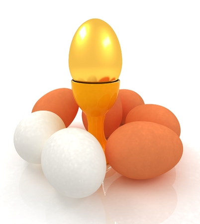 egg cups: Eggs and gold easter egg on egg cups  Stock Photo