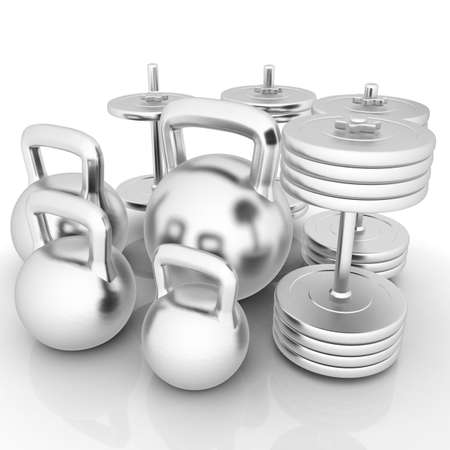 Metall weights and dumbbells on a white background photo