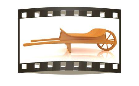manure: wooden wheelbarrow on a white background. The film strip Stock Photo