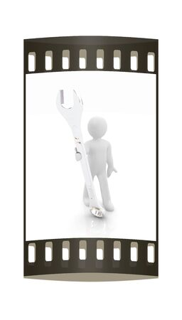 3d man - wrench in hands on a white background. The film strip