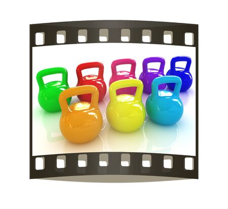 weights: Colorful weights on a white background. The film strip Stock Photo