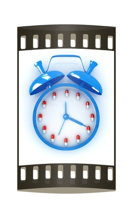 Alarm clock and tablet on a white background. The film strip photo