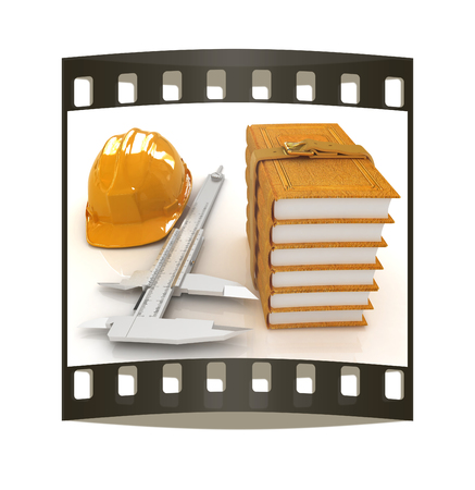 yellow hard hat: Vernier caliper, leather books and yellow hard hat on a white background. The film strip