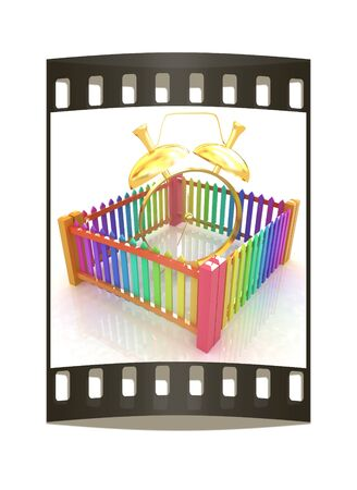 Time protection concept. Gold alarm clock clock closed colorfull fence on a white background. The film strip photo