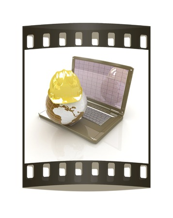 geodesist: Hard hat and earth on a laptop on a white background. The film strip Stock Photo