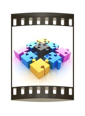 four elements: Puzzle of the four elements. Conceptual image - a palette CMYK. The film strip