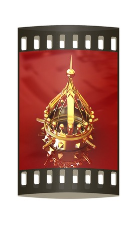 jeweled: Gold crown isolated on red background. The film strip