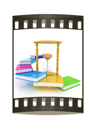 graduation countdown: Hourglass and books on a white background. The film strip Stock Photo