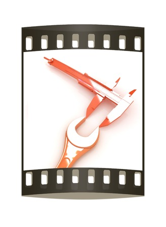 Trammel vernier on a white background measures the detail. The film strip photo