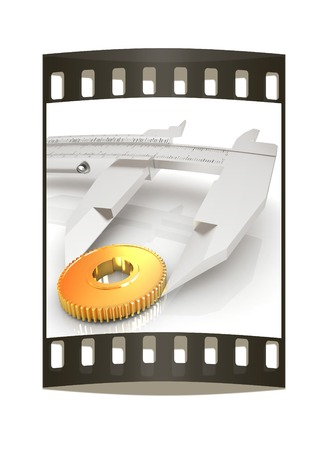 Vernier caliper measures the cogwheel on a white background. The film strip photo