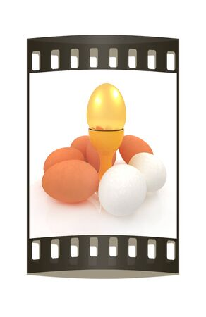 egg cups: Eggs and gold easter egg on egg cups. The film strip