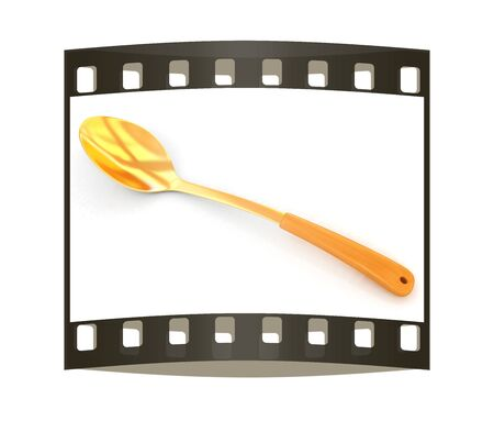stainless steel kitchen: gold long spoon on white background. The film strip