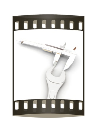 remount: Trammel vernier on a white background measures the detail. The film strip Stock Photo