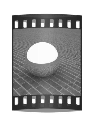 chrome ball: Chrome ball on the brick floor. The film strip Stock Photo