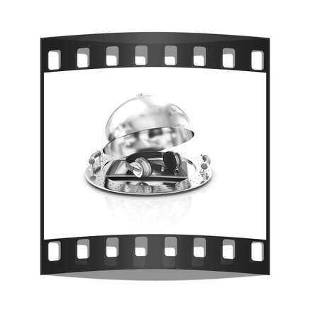 gprs: Phone and headphones on glossy salver dish under a cover on a white background. The film strip