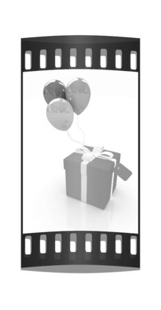 Gift box with balloon for summer on a white background. The film strip photo