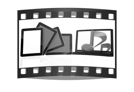 mpg: yellow note on the  laptop and  tablet pc on a white background. The film strip