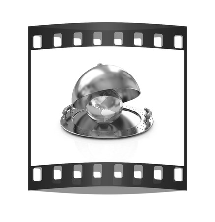 Earth globe on glossy golden salver dish under a golden cover on a white background. The film strip photo