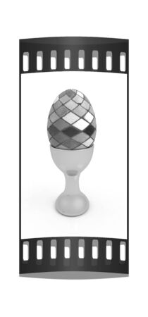 egg cups: Easter egg on gold egg cups on a white background. The film strip