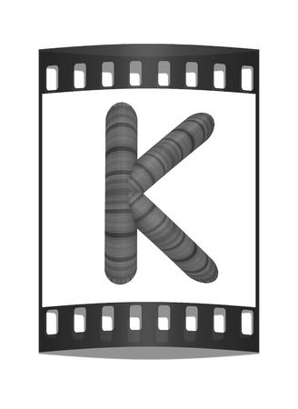 prinitng block: Wooden Alphabet. Letter K on a white background. The film strip