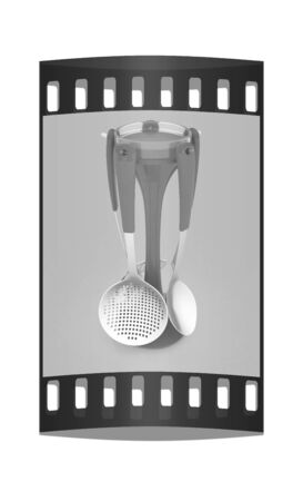 sizzle: cutlery on a light gray background. The film strip