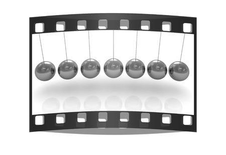 Newtons balls on white background. The film strip