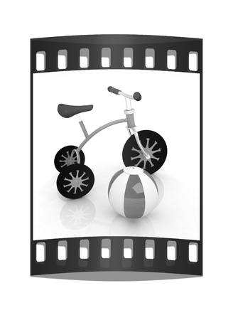 childrens bike with colorful aquatic ball on white background. The film strip Reklamní fotografie