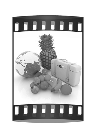 Citrus,earth and travelers suitcase on a white background. The film strip