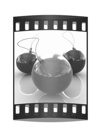 Traditional Christmas toys on a reflective background. The film strip